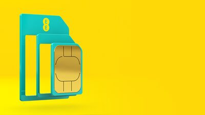 A green SIM card with the EE logo split into three pieces on a yellow background